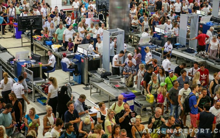 peak busy airport crowded crowd security checkpoint TSA Phoenix