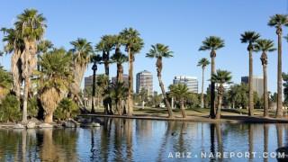 Encanto Park Lake Phoenix Arizona historical neighborhood palm trees skyline