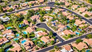 Phoenix home construction housing residential Scottsdale Ranch aerial cul-de-sac solar concrete tile roof