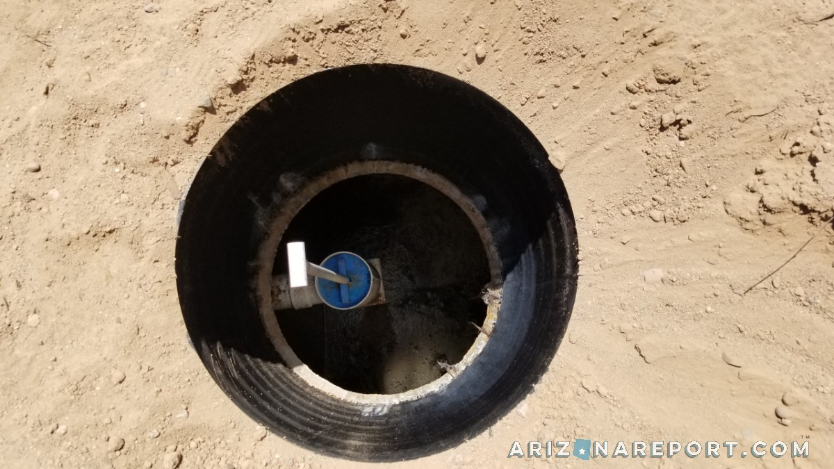 septic tank riser view down inside into outlet baffle