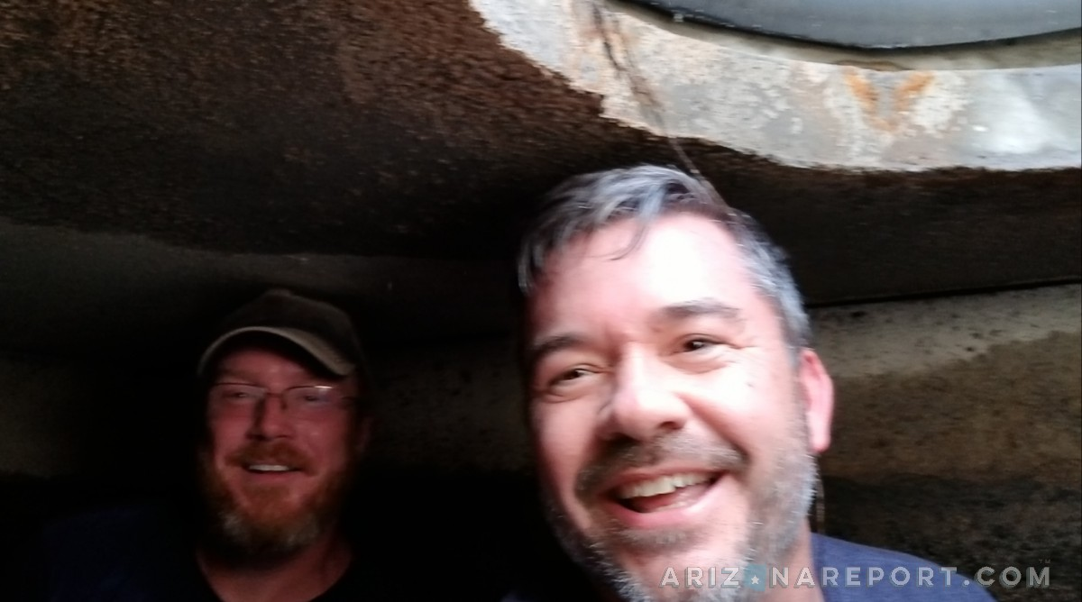 septic tank interior view riser inside two men