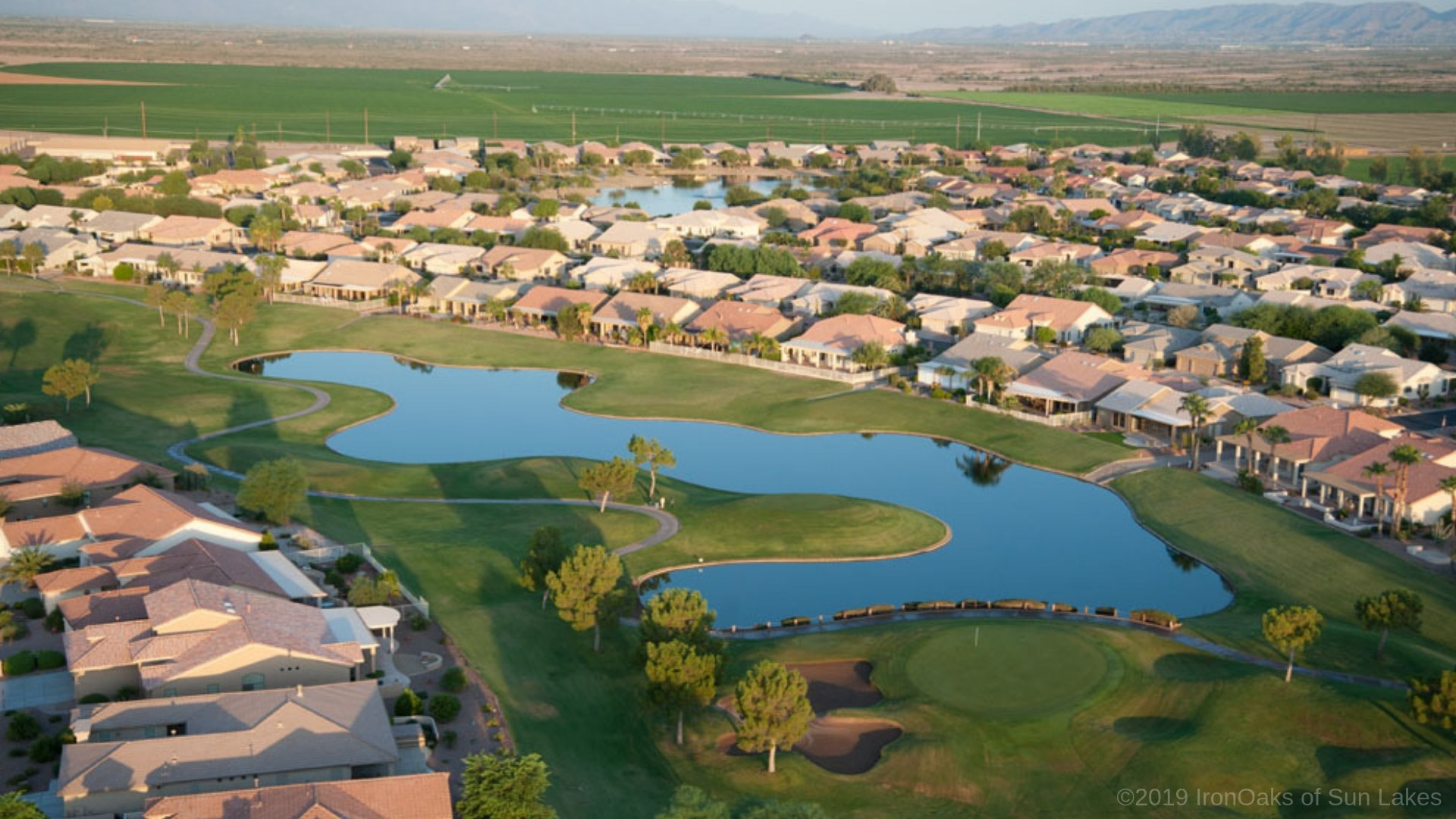 Evening over golf course pond and homes in Sun Lakes, Arizona
